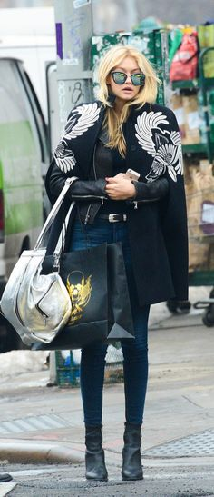 ☆ ℛebel ℬelle . Gigi Hadid Street Style: Cape and Leather Jacket With a Silver Bag and Mirrored Sunglasses