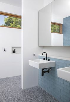 This mirrored cabinet provides much more than storage by reflecting outside views to instantly make the room feel bigger. His-and-hers wall-mounted basins are backed by blue tiles and a recessed shelf, ensuring the floor space is kept clear. Mirror Cabinets, Recessed Shelves, Bathroom Inspiration, Wall Mounted Basins, Amazing Bathrooms, Stone Walls Interior, Bathroom Interior Design, Zen Space, Bathroom Design
