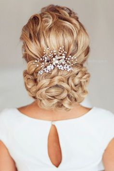 wedding braided updo hairstyles with pearl hair comb and pins