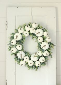 Fall Wreath ~ White Pumpkin Wreath ~ Fall Door Wreath ~ Fall Pumpkin Wreath This fall wreath is packed with white pumpkins and eucalyptus! It is all attached to a natural grapevine base. A beautiful indoor or outdoor wreath. The wreath measures approximately 22 in diameter. There is a small wire