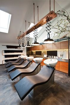 I love the 'wave' of these chairs - very appropriate for a riverside salon. Stunning and look comfortable shampoo chairs - shame I could not source the supplier!