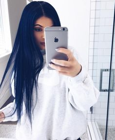 Over the weekend, Kylie Jenner broke out a brand-new wig. It wasn't an attention-grabbing cotton-candy pink or a bright mint green. It was a deep navy blue. And from some angles, it looks like a dark brown or black,...