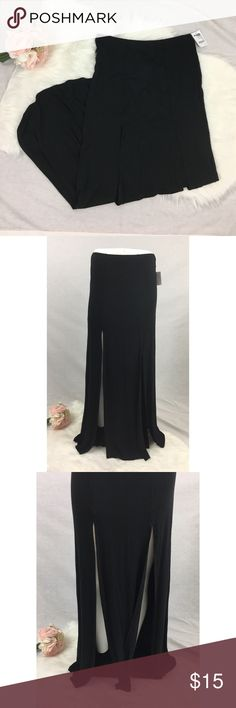 "NWT Black Maxi Skirt with High Slits BRAND NEW WITH TAGS AND NEVER WORN! Elastic waistband. Measures almost 42"". Has two high slits on front, measures about 28"". No tears or stains. No trades and no holds. Charlotte Russe Skirts Maxi"