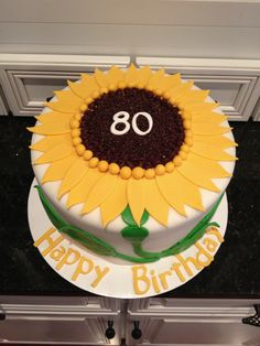 Sunflower birthday cake for 80 year old birthday party.