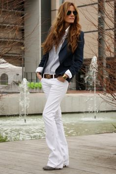Crisp white trousers, paired with a cuffed blazer, classic oxford, and fun belt. Cool, laid back, and oh so stylish.