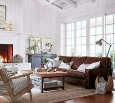 Rustic living room with a square arm leather sofa, Pottery Barn JODIE PRINTED RUG and vintage inspired furniture // Pottery Barn neutral rugs sale Brown Leather Couch Living Room, Dark Brown Couch, Brown Couch Decor, Brown Leather Couches, Over Couch Decor, Leather Sectional, New Living Room, Home And Living, Living Room Inspiration