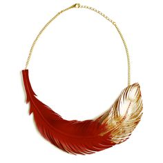 Gold leafing the leaf or feather!  Leather feather necklace