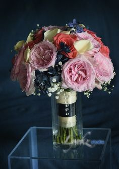 Bride's bouquet from Garden roses, coral roses white calla and blue delphiniums by Lynkzstudio