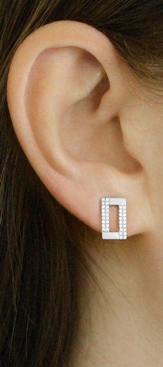 A cool combination of delicate diamond details and a contemporary sandblasted finish. #diamonds #earrings #studs #danarebecca