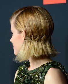 Kate Mara in Prada, bobby pinned sleek with deep set part
