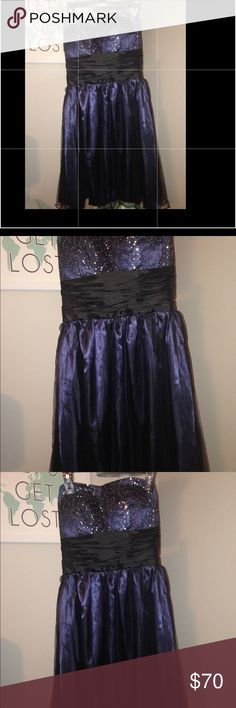 Navy short formal dress! Junior size 2/4 Beautiful nwot formal dress. Navy blue with beading on the top.  Never worn. It was to big for my daughter, and we couldn't ship back. Great for sweetheart dance, homecoming, prom.....etc. strapless, and zips on the side. Paid $213 new.   Our loss your gain!  Great buy!!  Pictures do not do this dress justice!! Alyce Paris Dresses Prom