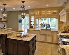 """I really """"have to"""" have a beautiful view from my next kitchen sink.  I also would love to have a small gallery or sun room near the kitchen.  The idea of an opening above the sink looking into the sunroom appeals to me."""