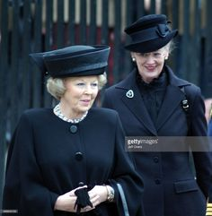 Queen Beatrix of Holland and Queen Margrethe II of Denmark at the funeral of Queen Elizabeth the Queen Mother at Westminster Abbey.