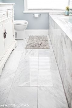 useful ideas in artcile - white/gray marble on floor and bath front - white subway on wall