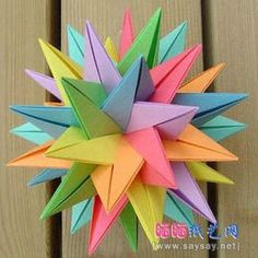 This project is so exquisite and colorful. It requires time, but it is worthy. I hope many Origami Maniacs are able to make it. 3d Origami Ball, Origami 3d Star, Origami And Kirigami, Paper Crafts Origami, Origami Easy, Oragami, Origami Design, Paper Flower Ball, Paper Flowers