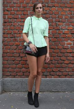Milan Street Style - Spring Summer Fashion 2013 /   Mint peplum  French Sleeve Color mint and cut peplum, with shorts and black boots, mini bag with appliqués geometric and spiked bracelet.