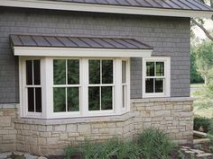 Exterior view of Marvin's Ultimate Alu Clad Wood Sliding Sash Windows Window Shutters Exterior, Exterior Design, House Front, Window Color, House Windows, Bay Window Exterior, Bow Window, Windows Exterior, Window Design
