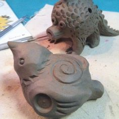 Bear Whistles! Bird Whistles! How to Build Sculptures that Sing. pinch pot clay sculpture