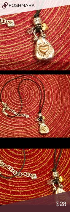 Brighton black leather cord pendant necklace Brighton necklace with black leather chain and silver/ gold pendant Brighton Jewelry Necklaces