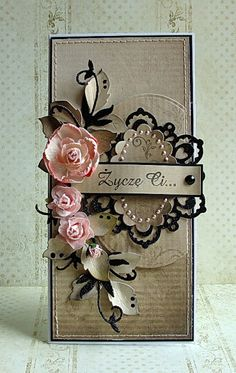 delightful tall card with pink flowers and black die cuts on creamy card...