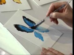 Butterflies using Watercolors by Susan Scheewe - AWESOME 2 min tutorial. An angled brush would be a must.