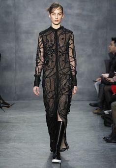 LOOK 20. Black geometric lace floor length button up shirt with cascades of black cotton petals.