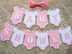10 DIY Onesies That Say BABY SHOWER with 3 meters of Ribbon. These come to you Un-Assembled, laser cut letters and accessories will need to be glued to the Onesies. Wonderful additions to Baby Showers. Idee Baby Shower, Shower Bebe, Baby Boy Shower, Baby Shower Gifts, Baby Shower Bunting, Ballerina Baby Showers, Bunting Flags, Flag Banners, Baby Banners
