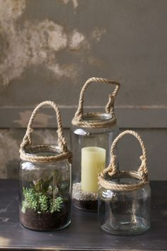 set of three glass candle holders with rope handles-one each size