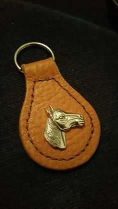 Check out this item in my Etsy shop https://www.etsy.com/uk/listing/244852423/leather-key-fob-with-concho-find-your