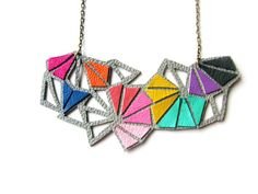 http://www.etsy.com/listing/88435007/geometric-necklace-triangle-kaleidoscope