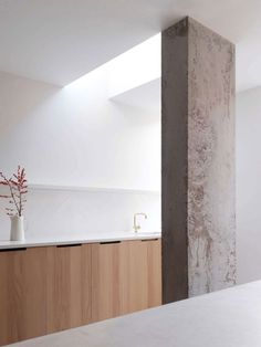 Kitchen with concrete column. Ingersoll Road by McLaren Excell.