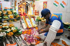 GOD-LIKE: A Sachin Tendulkar lookalike performs Hindu rituals as he participates in a religious ceremony for the victory of the Indian team in Ahmedabad. (Sam Panthaky/AFP/Getty Images)