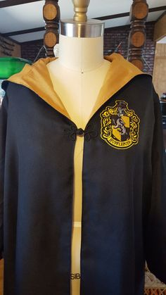 Harry Potter house robe with wand pocket and your choice of house patch/matching color lining. Hood is a pointed wizards hood and front of