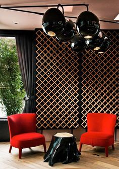 ♂ Commercial space design Black wine cellar wall with fresh red chair create a very strong contrast and contemporary look. A chic bohemian bar and restaurant designed by Nika Zupanc.