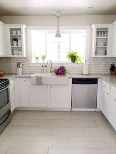 White kitchen, subway tile, farmhouse sink