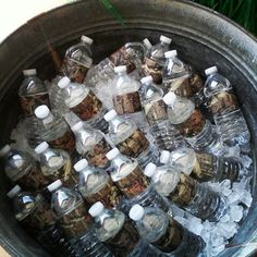 Used old wash tub filled with ice remove labels from water bottles and wrapped water bottles with camo duck tape for duck dynasty birthday party