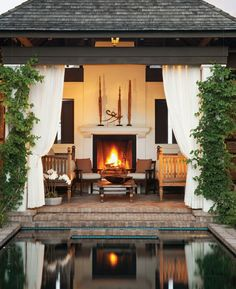White curtains, outdoor living, patio design, outdoor fireplace, poolside, outdoor furniture
