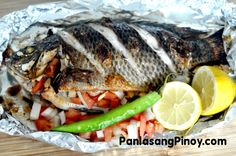"""Fresh Tilapia Recipe: Pi-na-pu-tok na Tilapia is a Filipino Recipe wherein Tilapia is stuffed with a generous amount of tomatoes, onions, and ginger up to the maximum point that the cavity of the fish can handle. The term """"pinaputok"""" is a Filipino word for explode or burst. It was used to describe"""