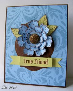"Made for this month's challenge.  I LOVE this new background stamp!  The colors were chosen from the colors on the package of brads: blue, brown and spring green.  blogged  supplies: CG291 Three Dotted Flowers CG405 Leaf and Floral Background CL564 Friend You're the Best Hero Hues Cerulean Chalk ink Memories Artprint Brown Nesties Labels Eighteen K&Co ""Roam"" fabric covered brads"