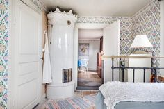 Swedish country house bedrom with old heating stove