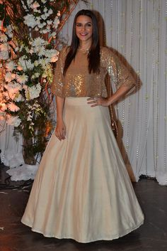 #NehaDhupia in a #sequinned crop top with silk #skirt