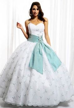 is a white dress with a blue ribbon at the waist and the dress has some decorations with glitter butterfly-shaped brooch with the battens with a price of three hundred and fifty pounds