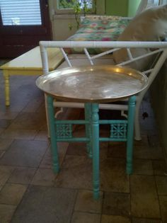 My Moroccan tray table polished up with Brasso and repainted in aqua. Paint: Martha Stewart Araucana Teal. I originally paid 25.00 for it.