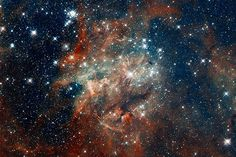 A Hubble space telescope image shows star cluster NGC 2060 at the heart of the Tarantula nebula 170,000 light-years away