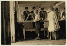 Cutting Sardines for 5 cents a box. Eastport, ME 1910(ish)