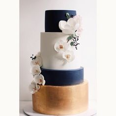 gold leaf with a rose gold finish, the deep midnight blue, super delicate sugar orchids, magnolia and hydrangeas...