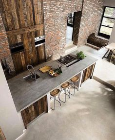 We love this rustic looking barn kitchen with concrete Worktops #barnkitchen #rustickitchen