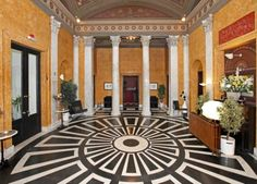 Hall: The entrance lobby is decorated in an antique style, dominated by marble columns and. Marble Columns, Marble Floor, Black And White Marble, International Real Estate, Mansions Homes, Floor Design, Luxury Homes, Taj Mahal, Entryway
