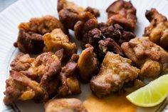 Spicy Chicken Nuggets (Chicharrones de Pollo) ~ Specialty of Puerto Rico and the Dominican Republic, these chicken nuggets are marinated in lime juice, rum, and soy sauce, dredged in flour and paprika and fried. ~ SimplyRecipes.com