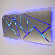 Metal Wall Art - Lighted Wall Art - Metal Wall Sculpture - Modern Wall Art - Geometric Wall Art - Abstract Art - LED Art - Contemporary Art  This sculpture is crafted entirely from aircraft grade aluminum, and features infused color changing LED lighting which you control via included wireless remote control, or with optional smart phone controller app (yes, you can do that, and its as cool as you think it might be! its just $35 more). This piece is one of my latest designs, inspired by…